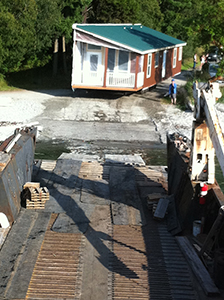 Moving modular homes to Lopez Island on the SJE.
